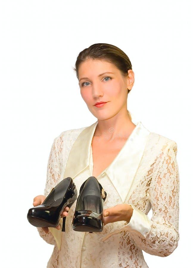 Mujer y zapatos aislados en blanco fotos de archivo libres de regalías