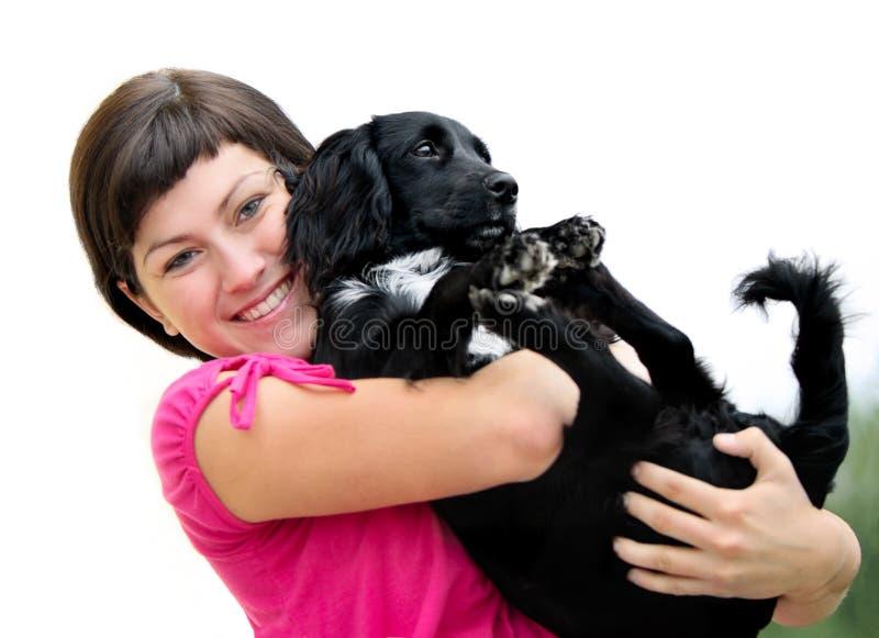 Mujeres con el perro foto de archivo