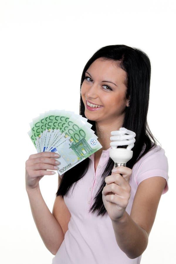 Mujeres con la lámpara ahorro de energía. Lámpara de la energía