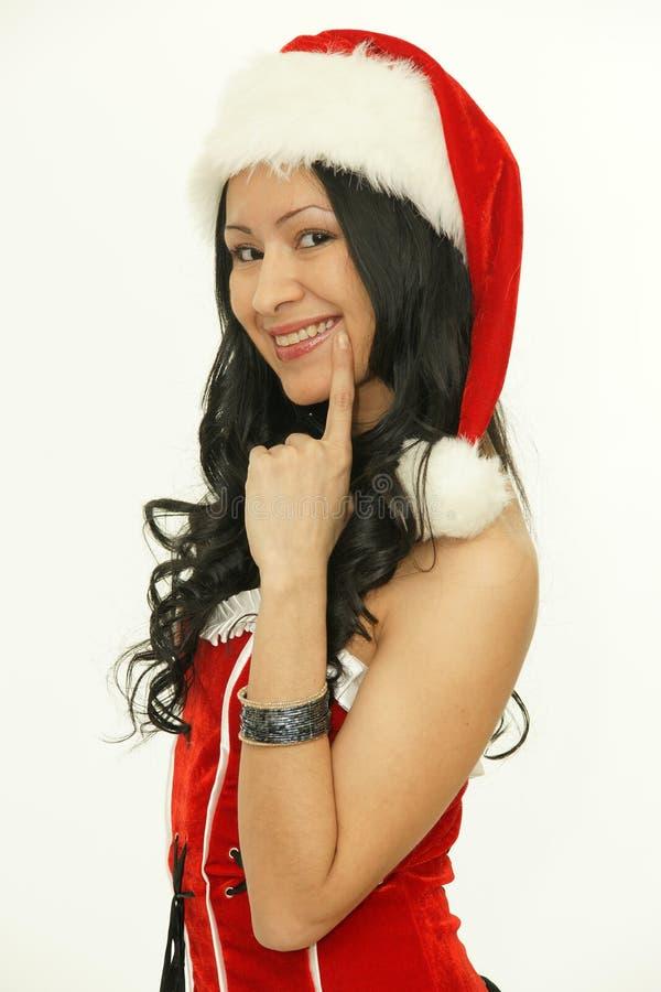 Mujeres de Santa con los bolsos Muchacha modelo asiática de la belleza en el sombrero de santa imagenes de archivo