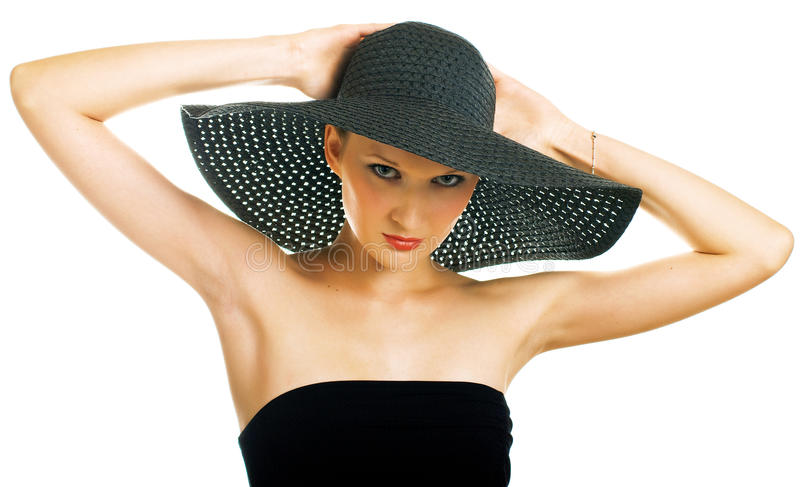 Mujeres hermosas en sombrero negro foto de archivo libre de regalías