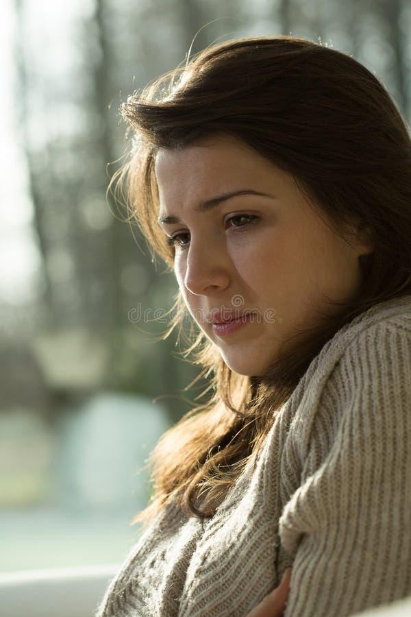 Mujeres jovenes con la depresión fotografía de archivo