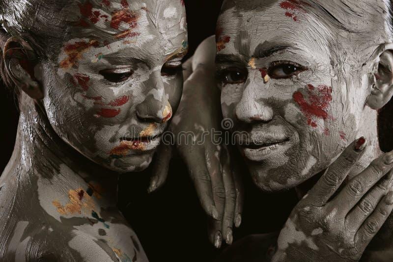 Mujeres pintadas con maquillaje imagenes de archivo