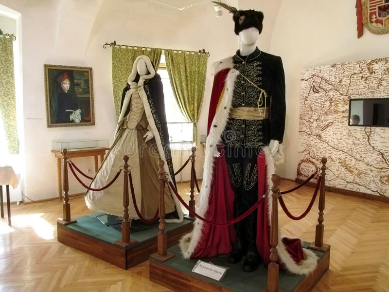 Vintage women's and men's costumes of Rakoczi Family Exposition at Palanok Castle Museum royalty free stock image