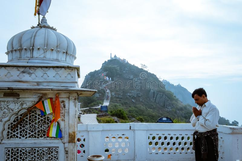 MUKTAGIRI, MADHYA PRADESH, INDIA MAY 5 2016: A jain pilgrim devotee meditating in front of famous historical Jainism Temple. Muktagiri is a Jain Pilgrimage royalty free stock photography