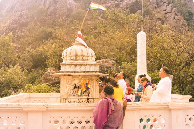 MUKTAGIRI, MADHYA PRADESH, INDIA MAY 5 2016: Jain pilgrim devotee meditating in front of famous historical Jainism Temple. MUKTAGIRI, MADHYA PRADESH, INDIA MAY royalty free stock photo