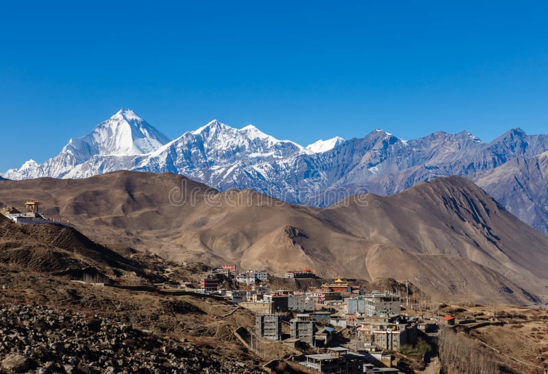 Muktinath village with Dhaulagiri. Peak at the background in Himalayas, Nepal stock image