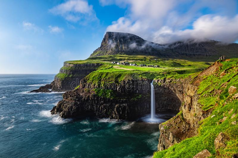 Mulafossur Waterfall in Faroe Islands. The Mulafossure waterfall on a sunny day in the Faroe Islands royalty free stock image