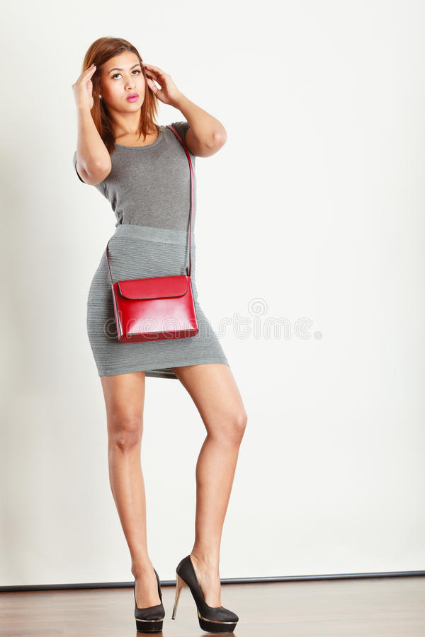 Free Mulatto Girl Gray Wear With Red Handbag Royalty Free Stock Image - 88588946