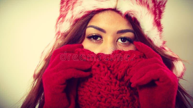 Mulatto woman wearing warm winter clothing, closeup royalty free stock photos