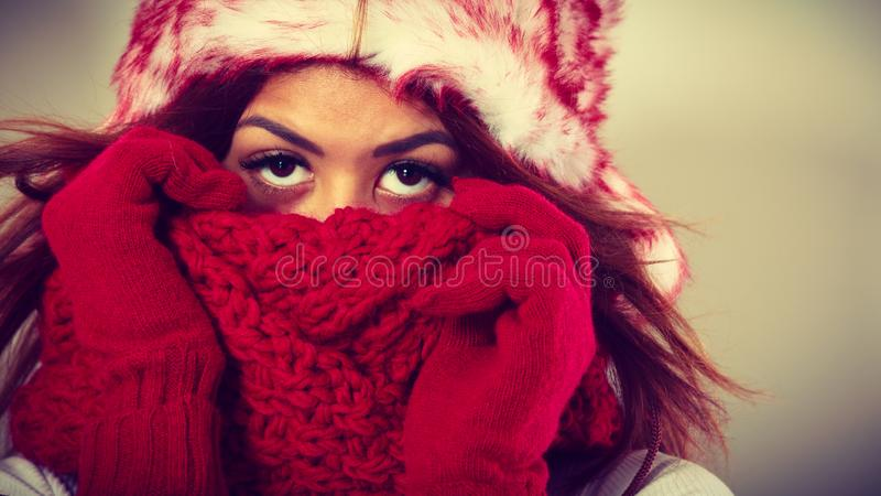 Mulatto woman wearing warm winter clothing, closeup stock images