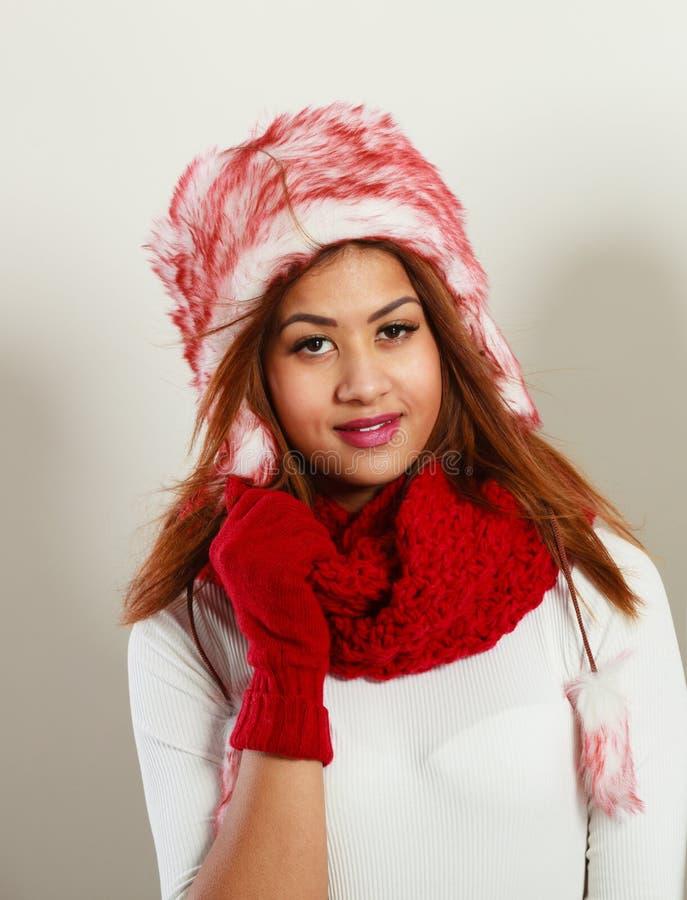 Mulatto woman wearing warm winter clothing stock photo