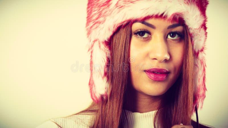 Mulatto woman wearing winter fur cap royalty free stock image
