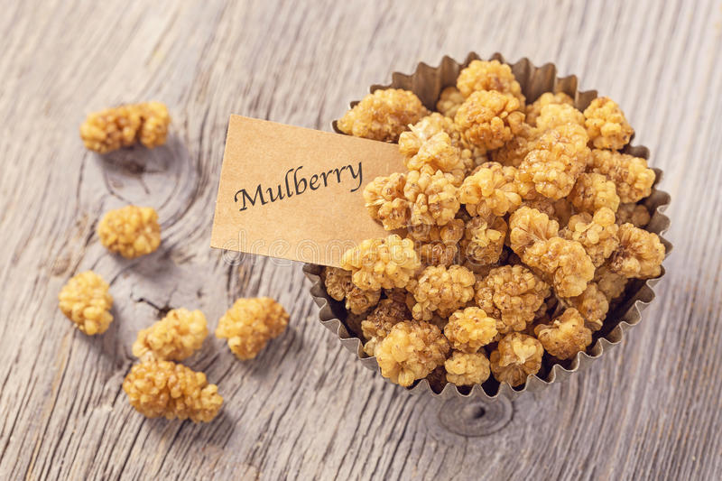 Mulberries in the bowl. With a tag stock photography
