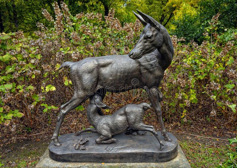 `Mule Deer` by A. Durenne in Turtle Creek Park in Dallas, Texas. Pictured is a cast iron sculpture titled `Mule Deer` by A. Durenne in Turtle Creek Park in stock photos