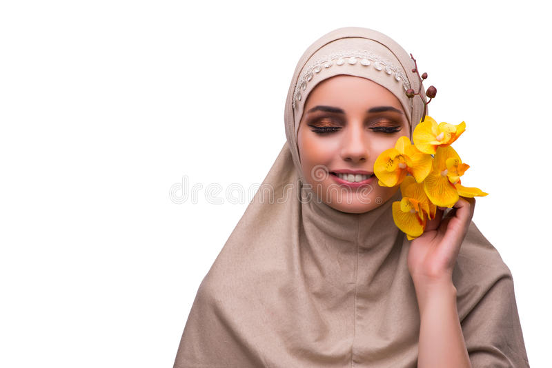 A mulher árabe com a flor da orquídea isolada no branco imagens de stock