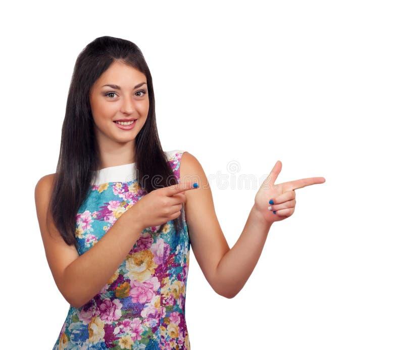 A mulher é de apresentação ou apontando com seu dedo fotografia de stock royalty free