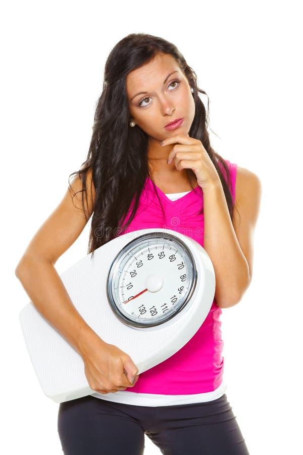 A mulher é descontentada com peso de corpo fotografia de stock