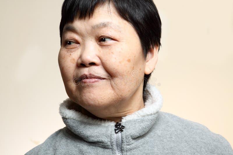 mulher 60s asiática sênior imagens de stock royalty free
