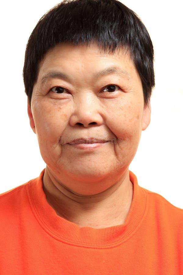 Mulher 60s asiática sênior feliz fotos de stock