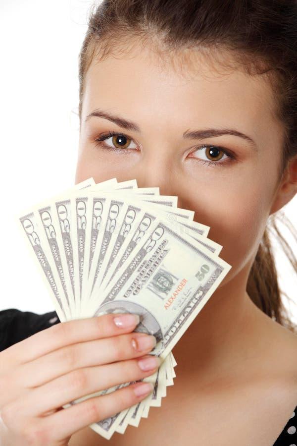 Mulher adolescente com dólares. foto de stock royalty free