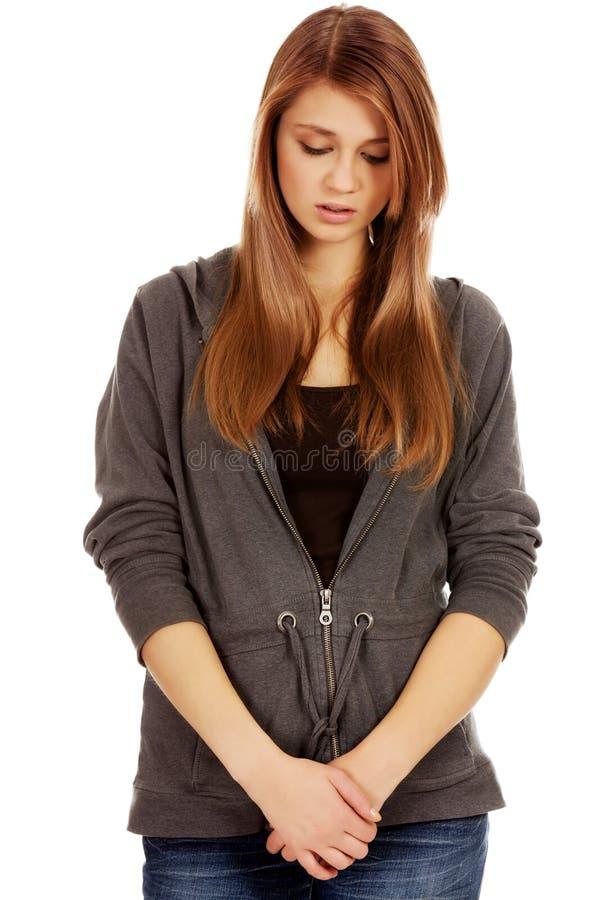 Mulher adolescente infeliz e pensativa fotos de stock