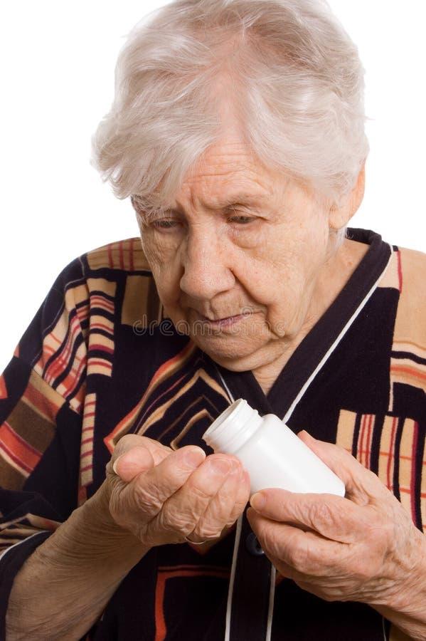 Mulher adulta na tabuleta branca do whith foto de stock