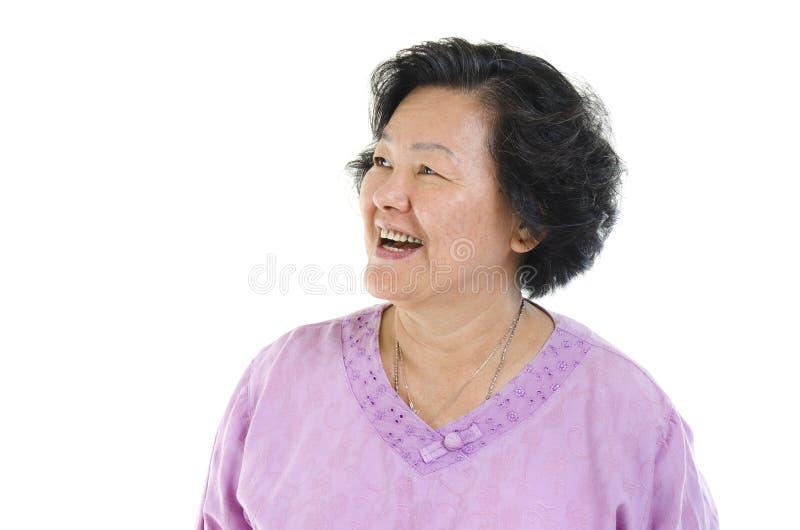 Mulher adulta superior que olha o lado foto de stock royalty free