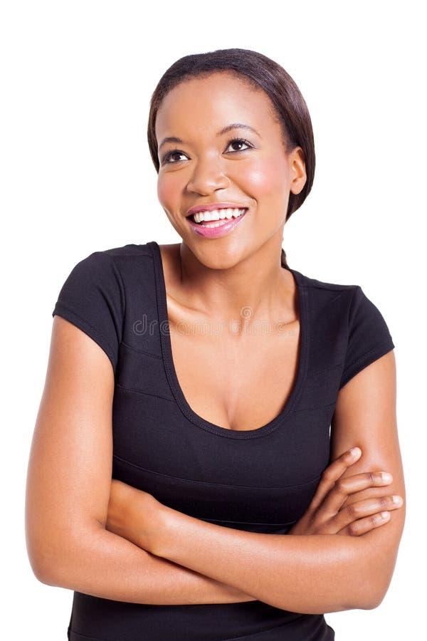 Mulher africana que olha acima foto de stock