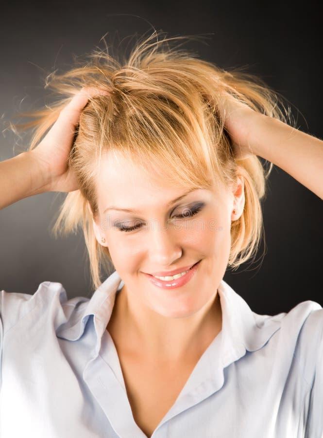 Mulher alegre com cabelo dishevelled imagens de stock