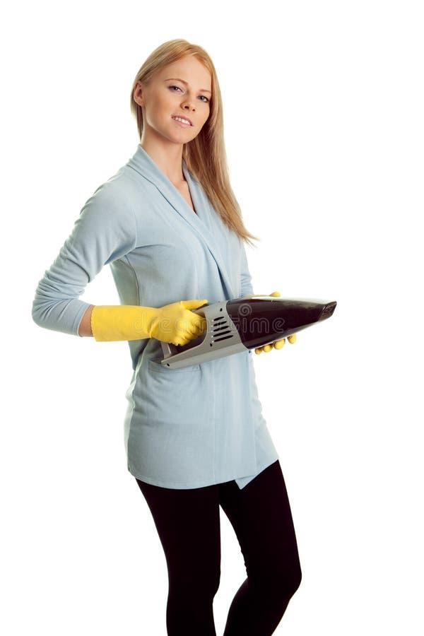 Mulher alegre com o aspirador de p30 handheld fotografia de stock royalty free