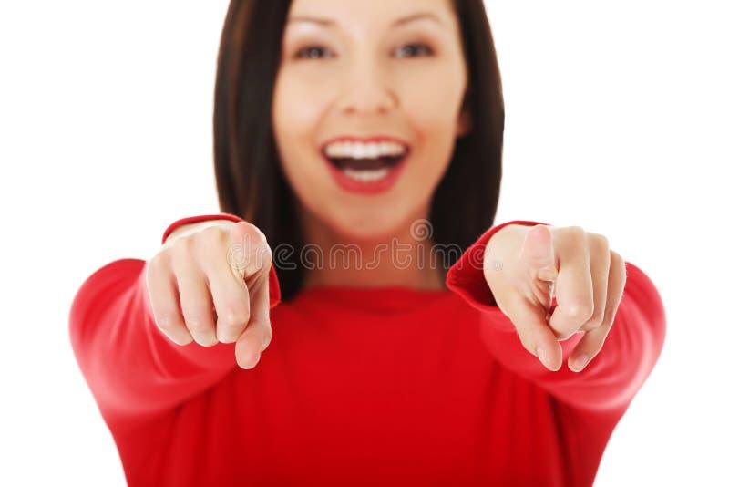 Mulher alegre do estudante que aponta em você imagens de stock royalty free