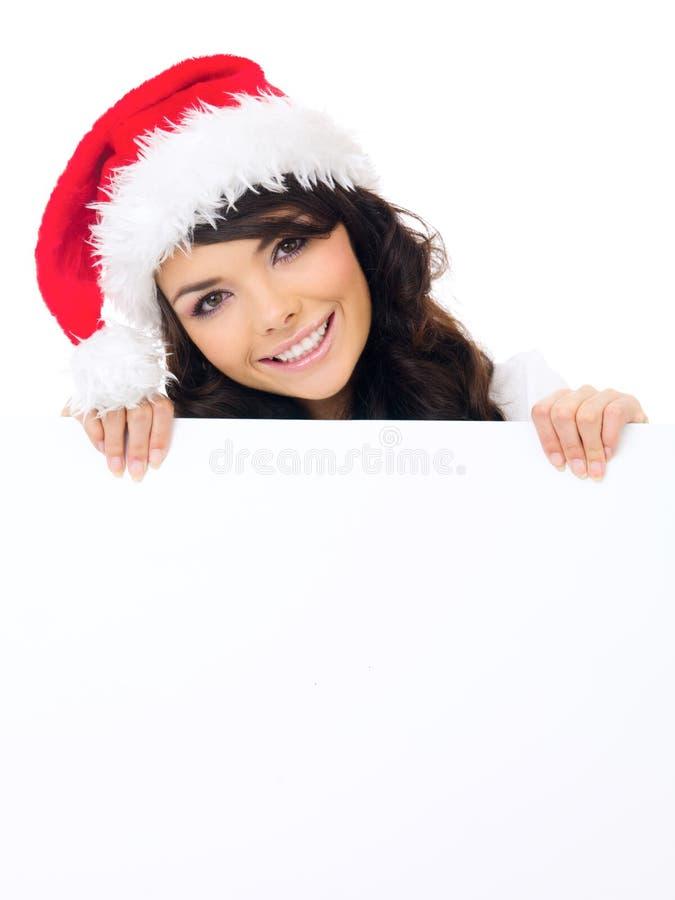 Mulher amigável com um sinal vazio do Natal imagem de stock