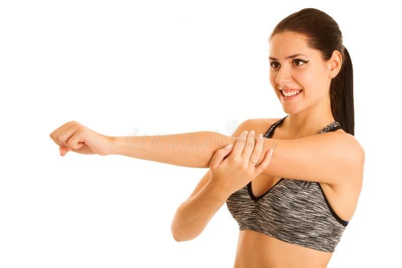 Mulher apta dos jovens ativos que estica o braço isolado sobre o backgr branco imagens de stock royalty free