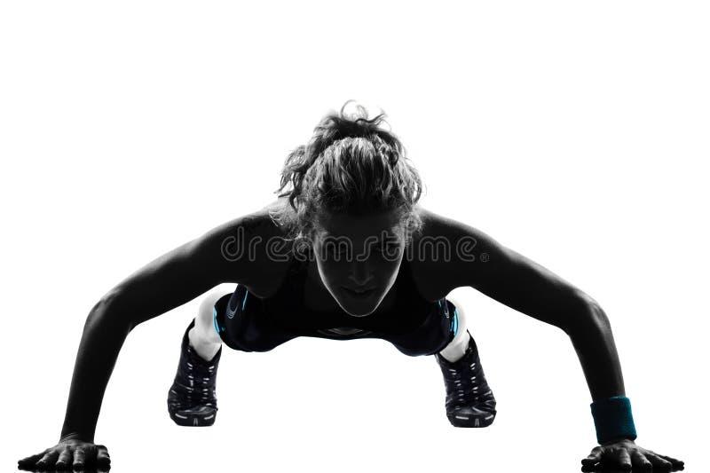 A mulher a aptidão do exercício que empurra levanta a postura foto de stock royalty free