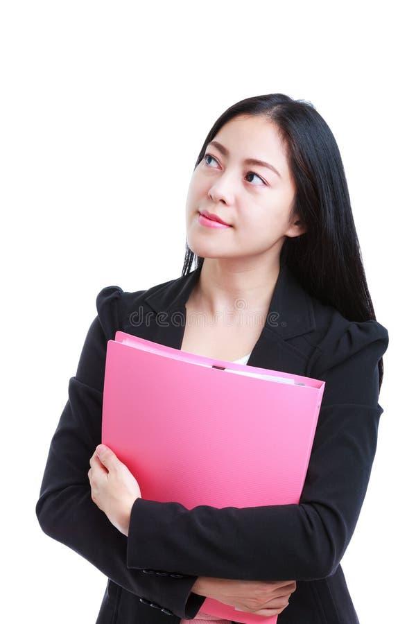Mulher asiática bem sucedida que olha pensativo seguro isolado sobre fotos de stock