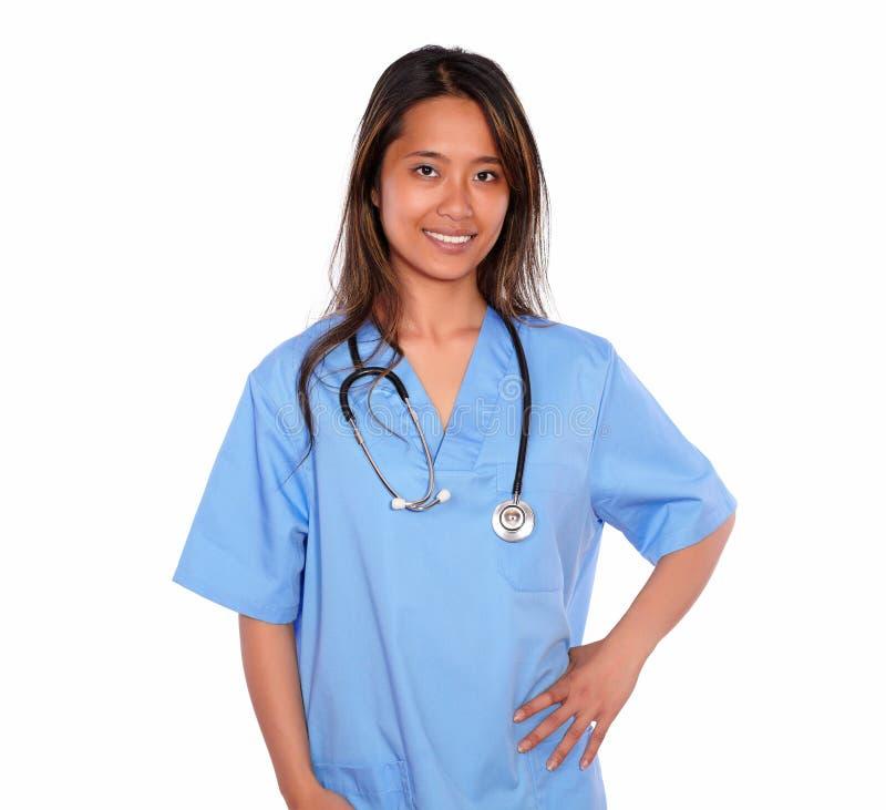Mulher asiática encantador da enfermeira que olha o imagem de stock royalty free