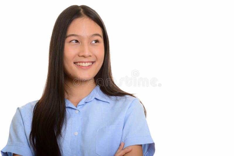 Mulher asiática feliz nova que sorri e que pensa imagens de stock