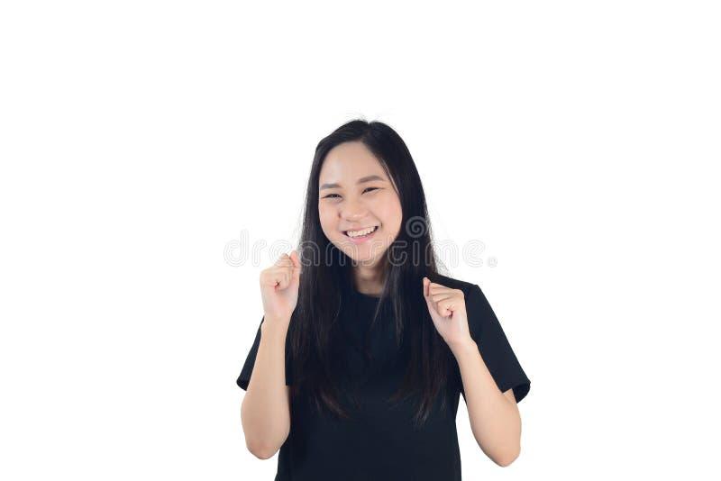 Mulher asiática nova alegre que olha acima com mãos sobre para o divertimento e imagens de stock