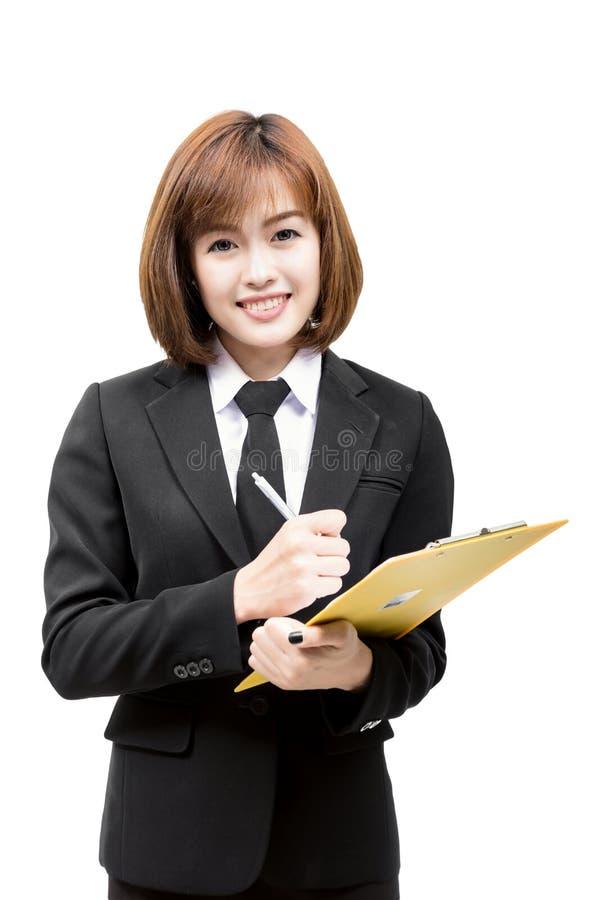 Mulher asiática nova bonita que tem uma pasta de arquivos foto de stock