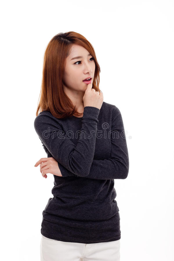 Mulher asiática nova de pensamento fotografia de stock
