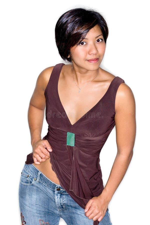 Mulher asiática nova na parte superior marrom foto de stock royalty free