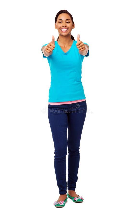 Mulher asiática nova que gesticula os polegares acima imagem de stock royalty free