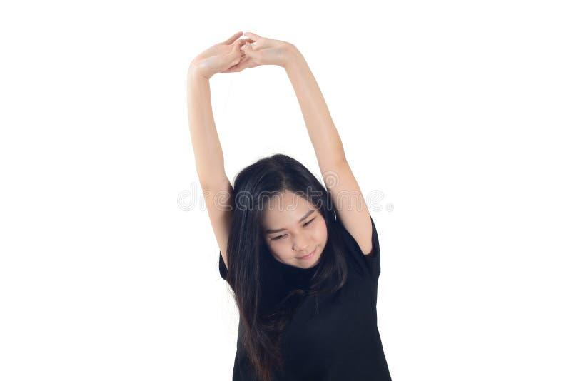 Mulher asiática que estica o isolado no branco como o fundo imagem de stock royalty free
