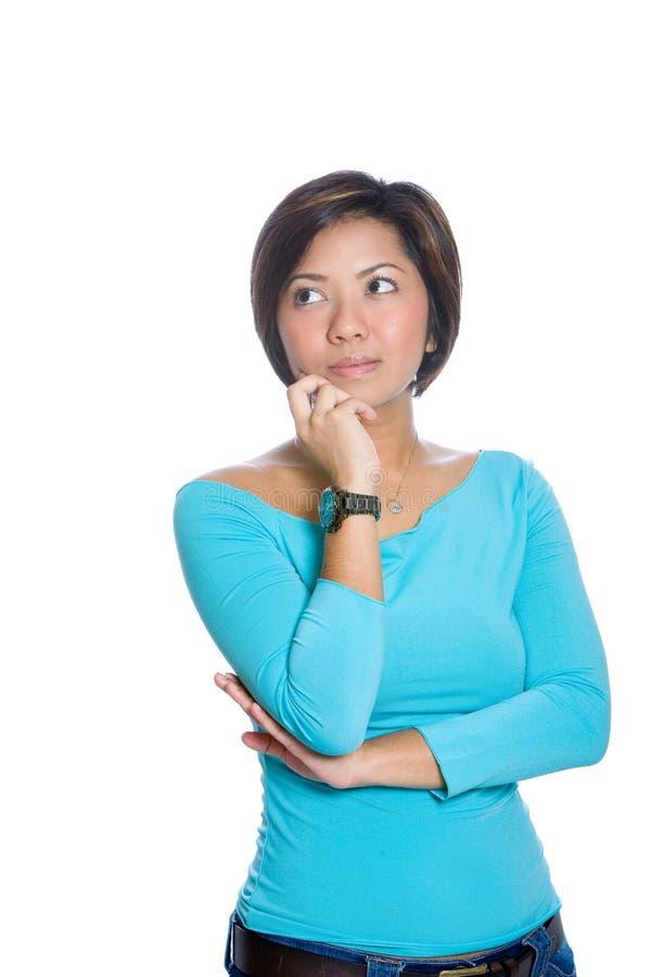 Mulher asiática que parece pensativa, isolado foto de stock royalty free