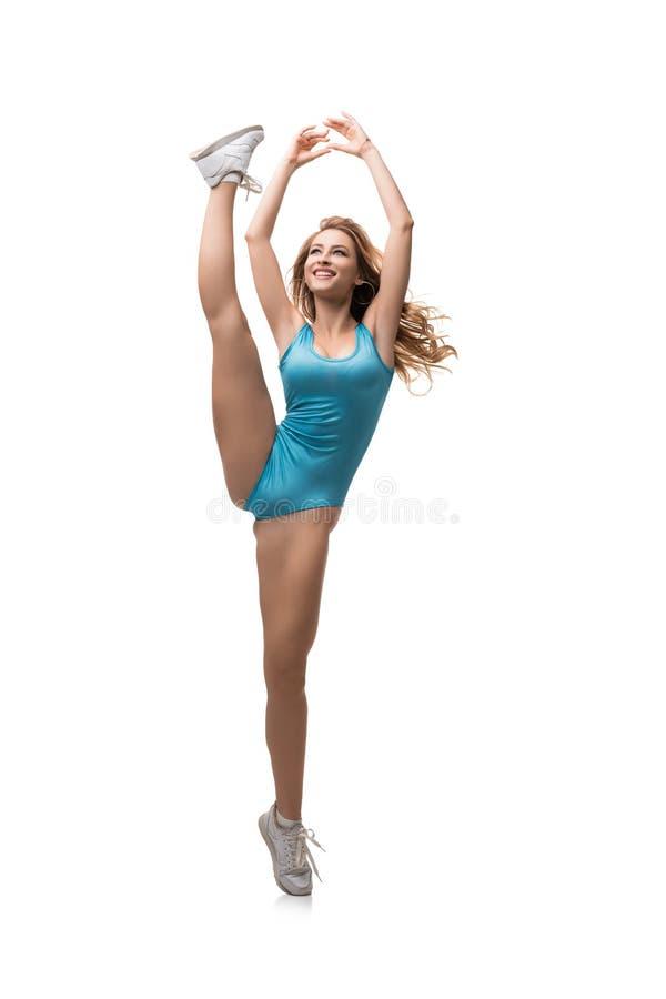 Mulher atlética no pé da posição do roupa de banho acima imagem de stock
