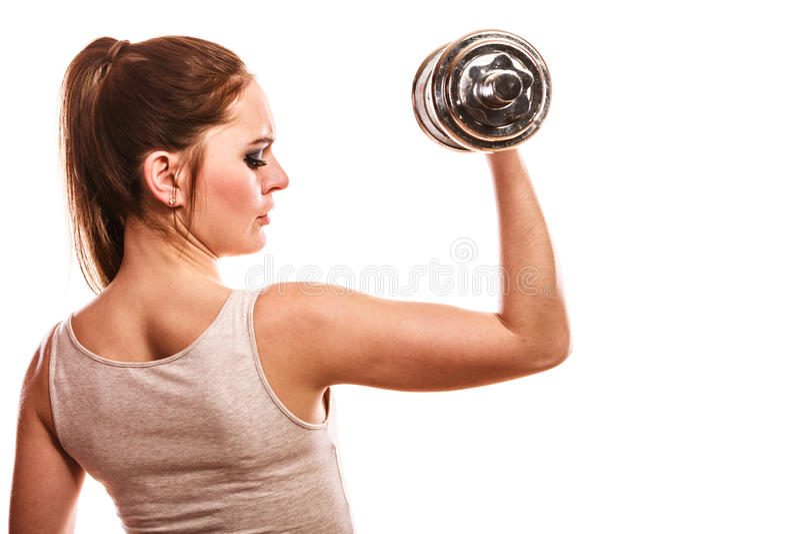 Mulher atlética que trabalha com pesos pesados imagens de stock