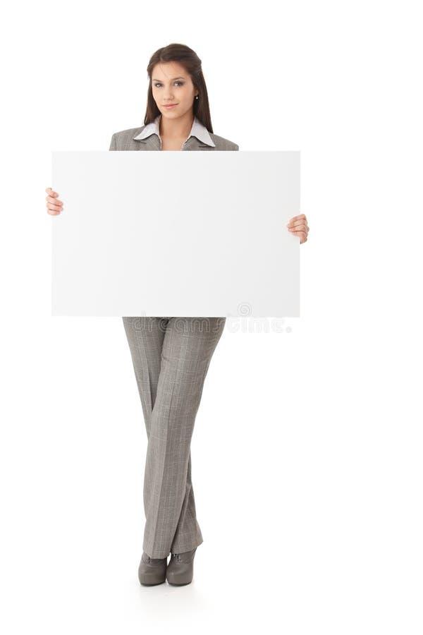 Mulher atrativa com painel branco fotos de stock royalty free