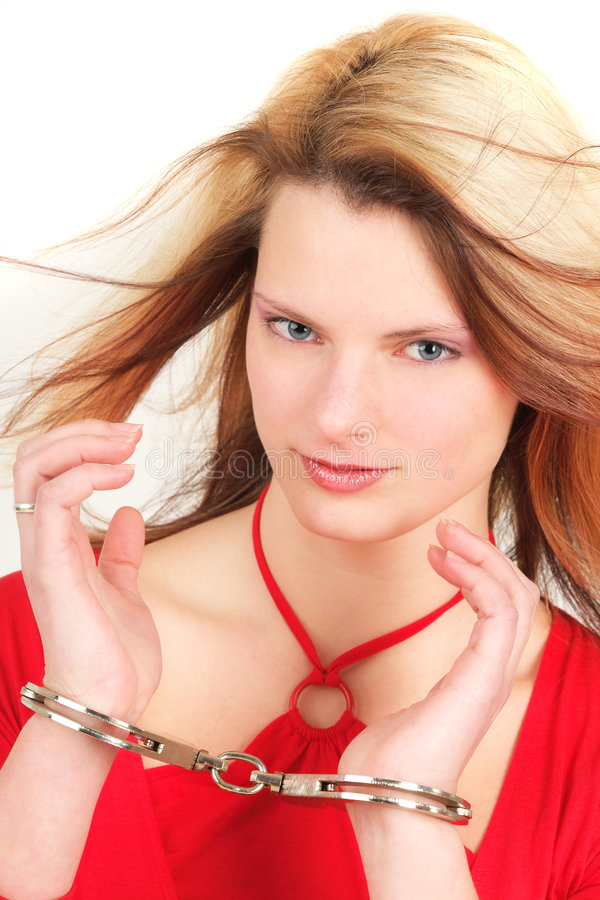 Mulher atrativa nas algemas fotografia de stock royalty free