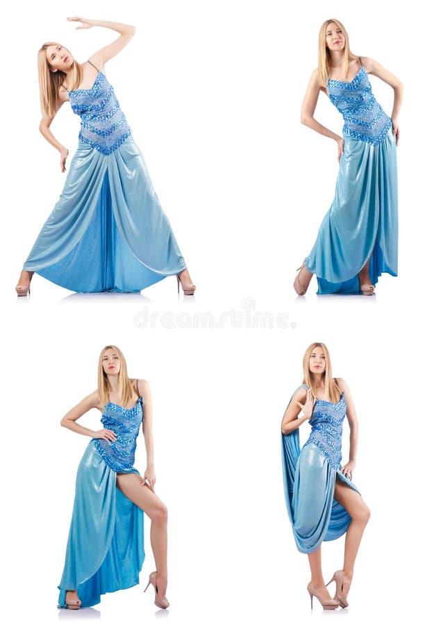 A mulher atrativa no vestido azul no branco imagem de stock